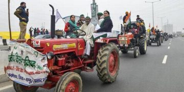 File photo of farmers holding a tractor rally during their ongoing protest against the new farm laws at Ghazipur near New Delhi (Photo Credit: PTI)