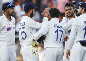 **EDS: TWITTER IMAGE POSTED BY @BCCI ON THURSDAY, FEB. 25, 2021** Ahmedabad: Indian team celebrates the dismissal of England's Joe Root on the second day of the 3rd cricket test match between India and England, at Narendra Modi Stadium in Ahmedabad, Thursday, Feb. 25, 2021. (PTI Photo) (PTI02_25_2021_000187B)