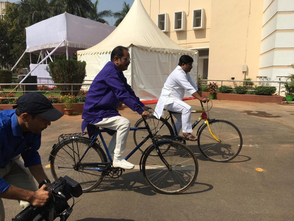 Congress MLAs ride bicycle to Assembly