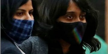 File photo of environment activist Disha Ravi (right)