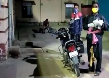 Bargarh Raincoat clad COVID patient rides to hospital in absence of ambulance, PPE kit