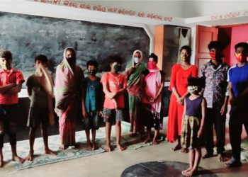 People at a cyclone shelter in Bhadrak district