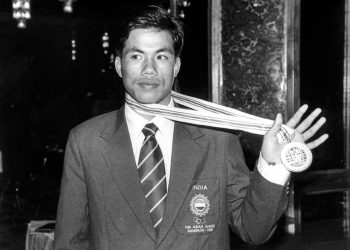 **EDS: FILE PHOTO** New Delhi: In this file photo circa 1998, boxer Dingko Singh shows his gold medal. 1998 Asian Games gold medal-winning former boxer Dingko Singh died after a long battle with liver cancer, on Thursday, June 10, 2021. He was 42 and had been fighting the disease since 2017. (PTI Photo)