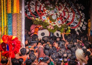 Lord Jagannath being escorted to His chariot Nandighosha