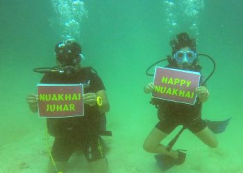 Young scuba diver, father send out Nuakhai wishes from 40-feet below sea